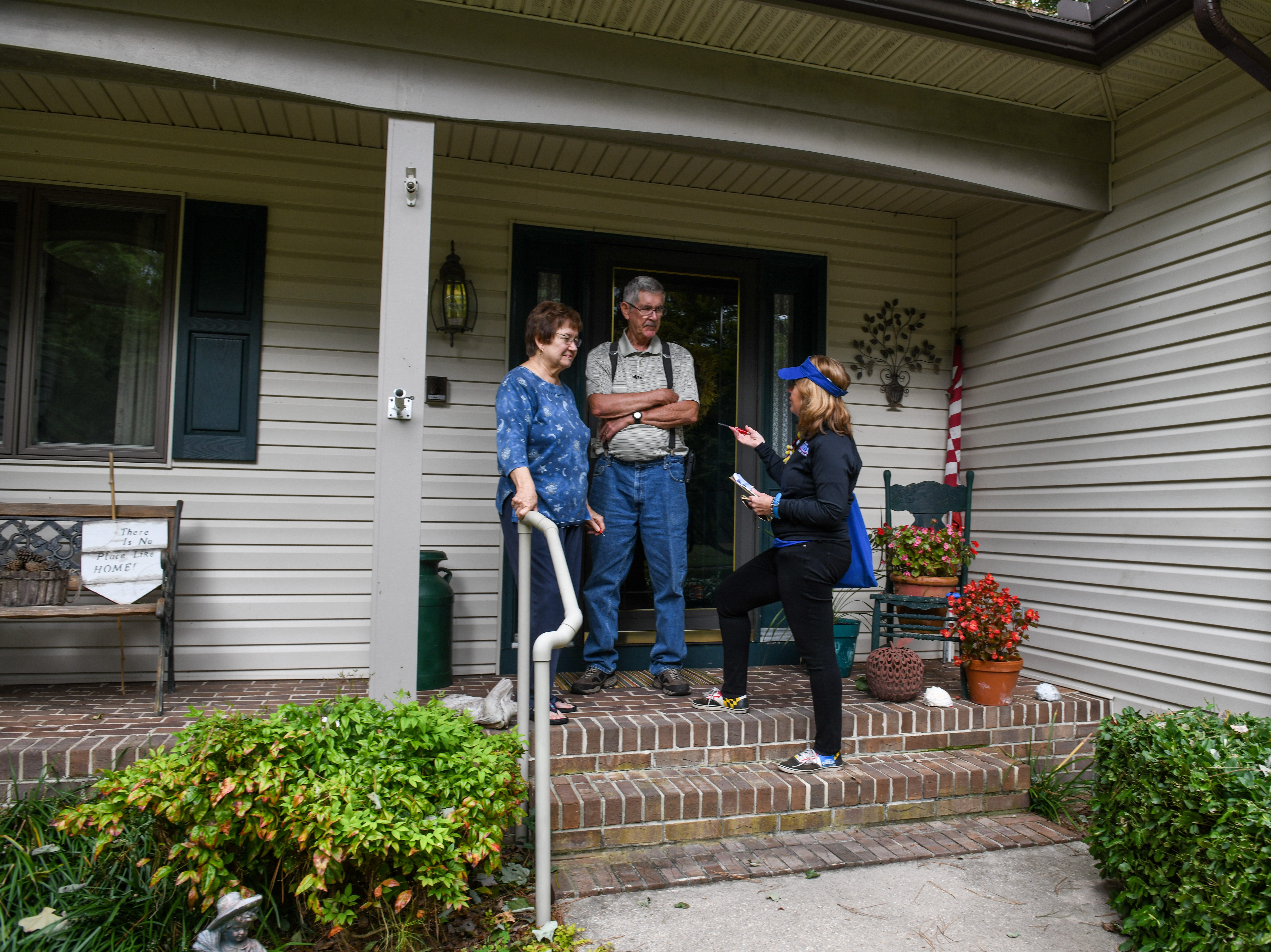 Delegate Mary Beth Carozza, Republican candidate for Maryland State Senate in District 38, talks to voters Andy and Sandy Bouma while canvassing in Salisbury on Saturday, Oct 13, 2018.