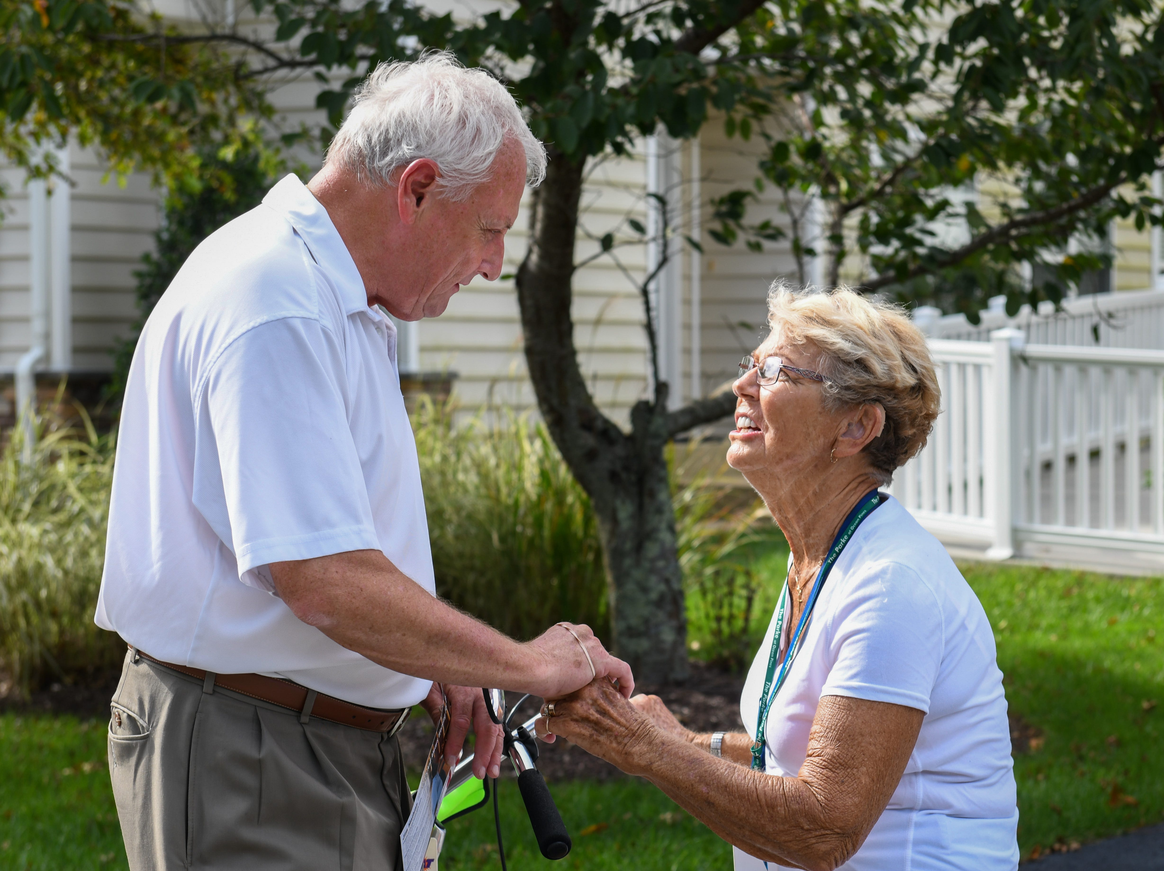 Sen. Jim Mathias, Democratic incumbent candidate for Maryland State Senate in District 38, talks to voter Hatty Ketterman in Ocean Pines while campaigning door to door on Tuesday, Oct 2, 2018.