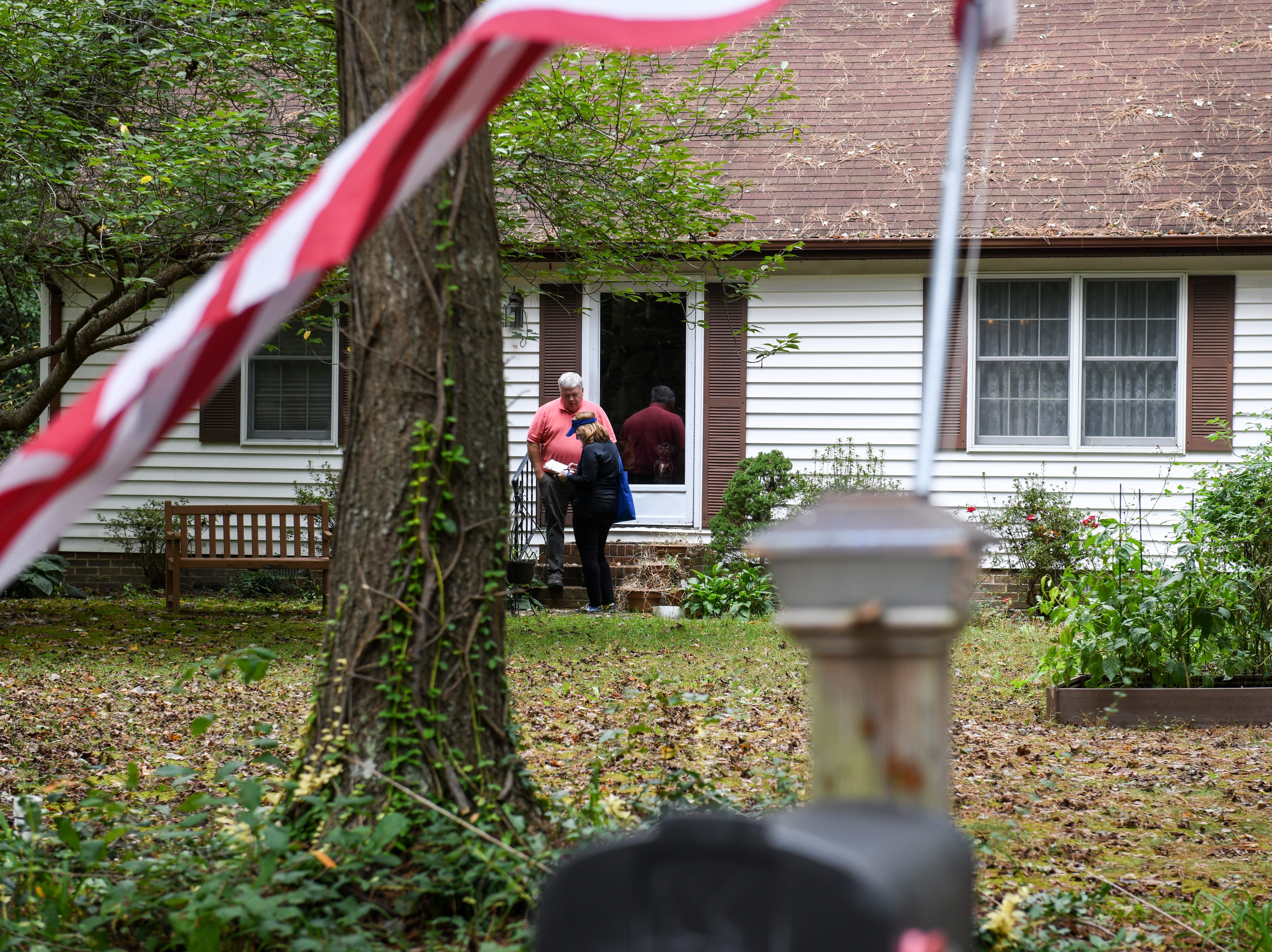 Delegate Mary Beth Carozza, Republican candidate for Maryland State Senate in District 38, talks to voter Jerry Douglas while canvassing in Salisbury on Saturday, Oct 13, 2018.