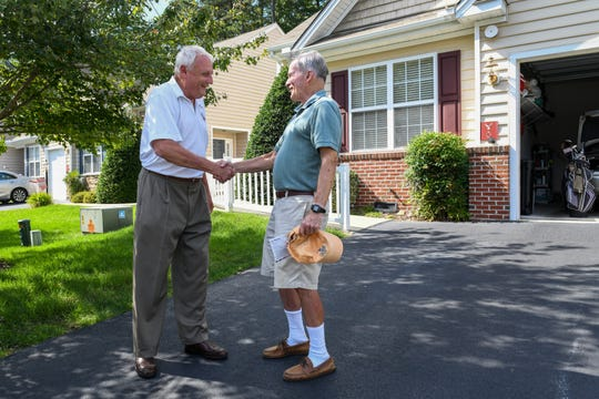 Sen. Jim Mathias, Democratic incumbent candidate for Maryland State Senate in District 38, talks to voter Dave Keller in Ocean Pines while campaigning door to door on Tuesday, Oct 2, 2018.