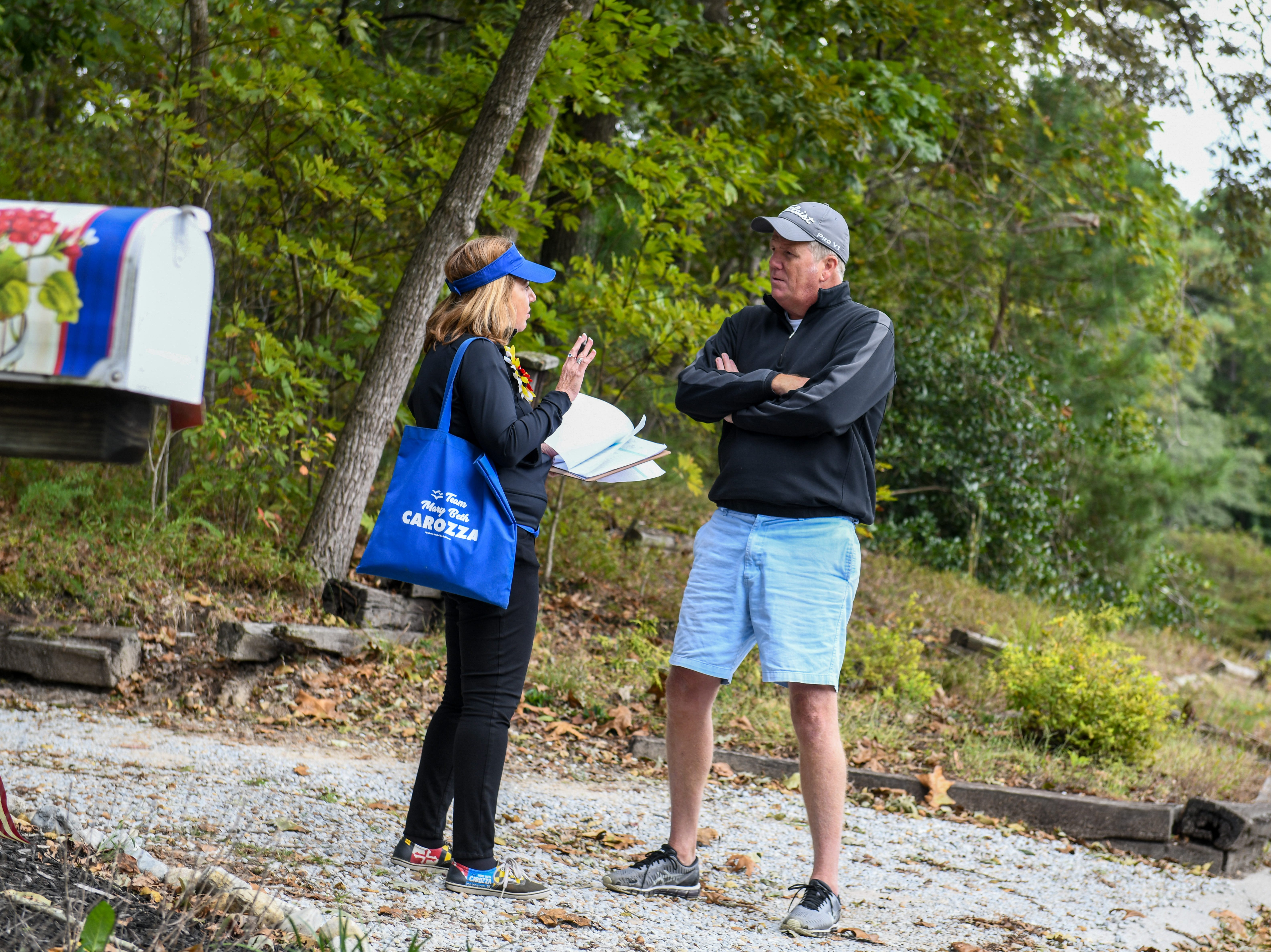 Delegate Mary Beth Carozza, Republican candidate for Maryland State Senate in District 38, talks to a voter while canvassing in Salisbury on Saturday, Oct 13, 2018.
