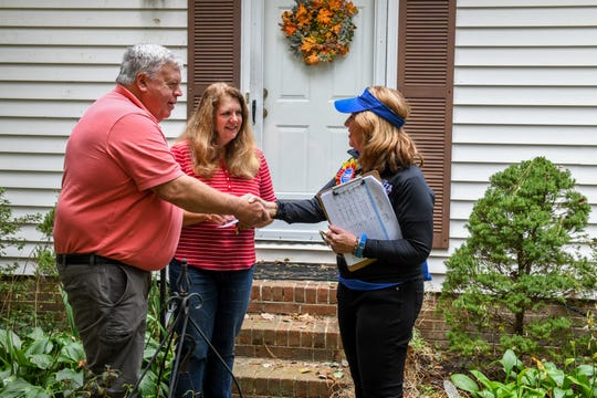 Delegate Mary Beth Carozza, Republican candidate for Maryland State Senate in District 38, talks to voters Jerry and Karla Douglas while canvassing in Salisbury on Saturday, Oct 13, 2018.