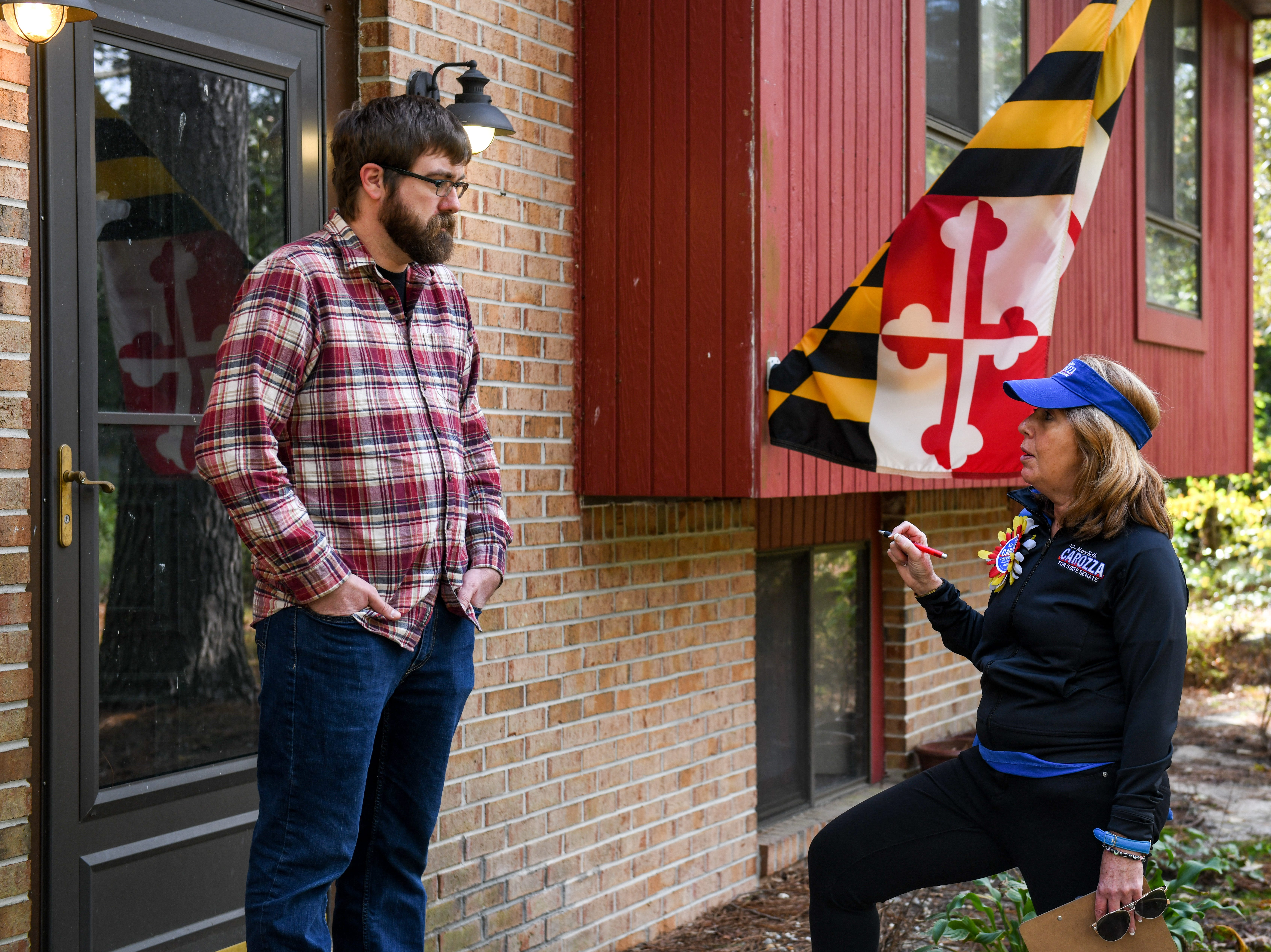 Delegate Mary Beth Carozza, Republican candidate for Maryland State Senate in District 38, talks to voter Chuck Porter while canvassing in Salisbury on Saturday, Oct 13, 2018.