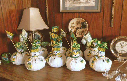 Shoreline Woman's Club members created these Packer Snowmen.