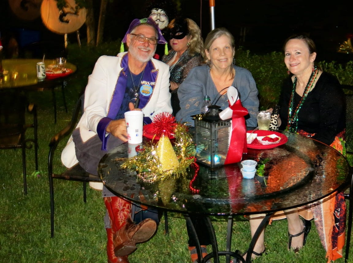 Artists Bruce Allen and Kristin Hanna with Laura Butler at the Krewe of Highland Coronation.