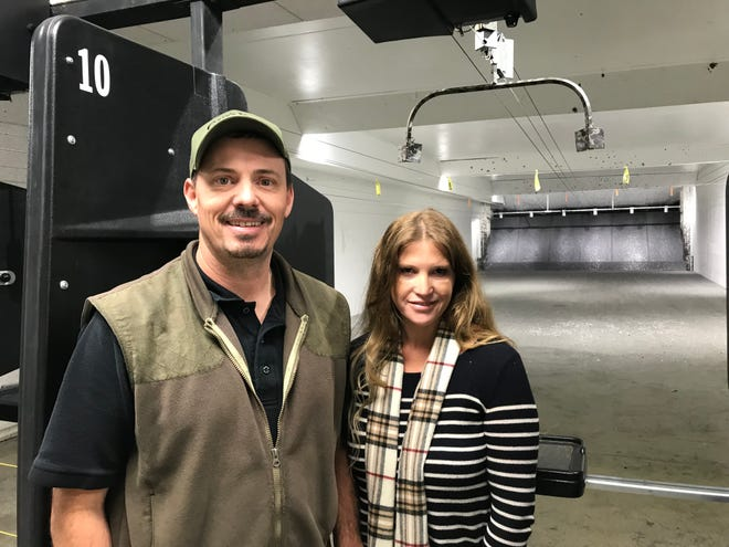 Tony and Tracy Naatjes, of Gary's Gun Shop in Sioux Falls, stand in their newly renovated indoor range in their store.