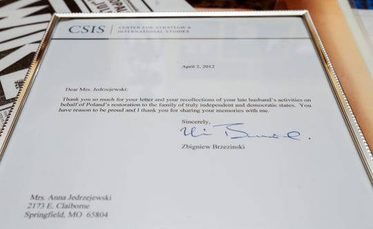 A framed letter sent to Anna Jedrzejewski that went along with the award given to her late husband Zbigniew Jedrzejewski for his involvement in the Solidarity labor and political movement in Poland.