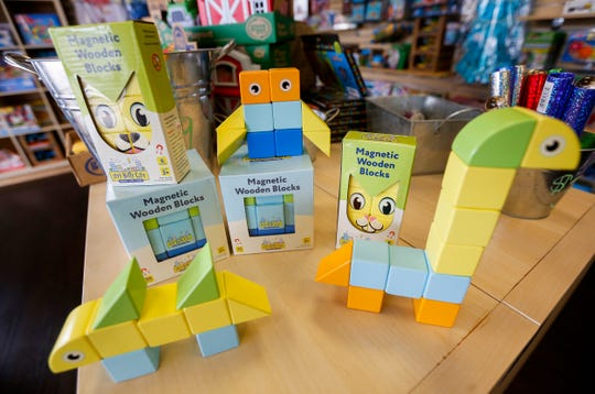 Craig and Fawn Rechkemmer, owners of Itty Bitty City, have created a line of magnetic wooden blocks for children.