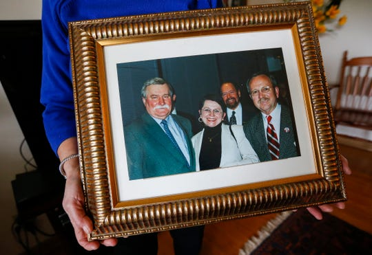 A photograph of Anna Jedrzejewsk, center, and her late husband Zbigniew Jedrzejewski, right, with former Polish President Lech Walesa, left.