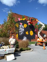 Artist Nils Westergard painting a mural on Oct. 13, 2018 in Waynesboro for the Virginia Street Art Festival.