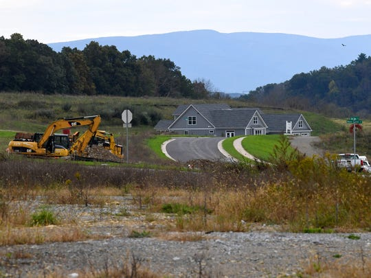 A view across land ready for development, looking towards a model home at Myers Corner in Fishersville.