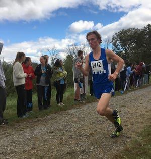 Robert E. Lee's Oliver Wilson-Cook competes in the Third Battle of Winchester Invitational cross country meet on Saturday, Oct. 13, 2018, in Winchester, Va. Wilson-Cook placed 10th overall with a personal-best time of 15:42.90.