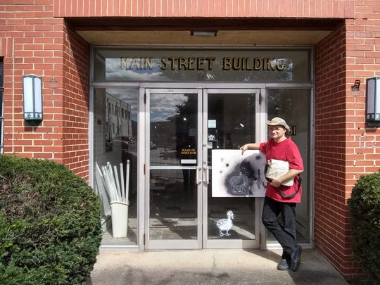 Artist Terry Ward with his duck mural on Oct. 13, 2018 in Waynesboro for the Virginia Street Art Festival.