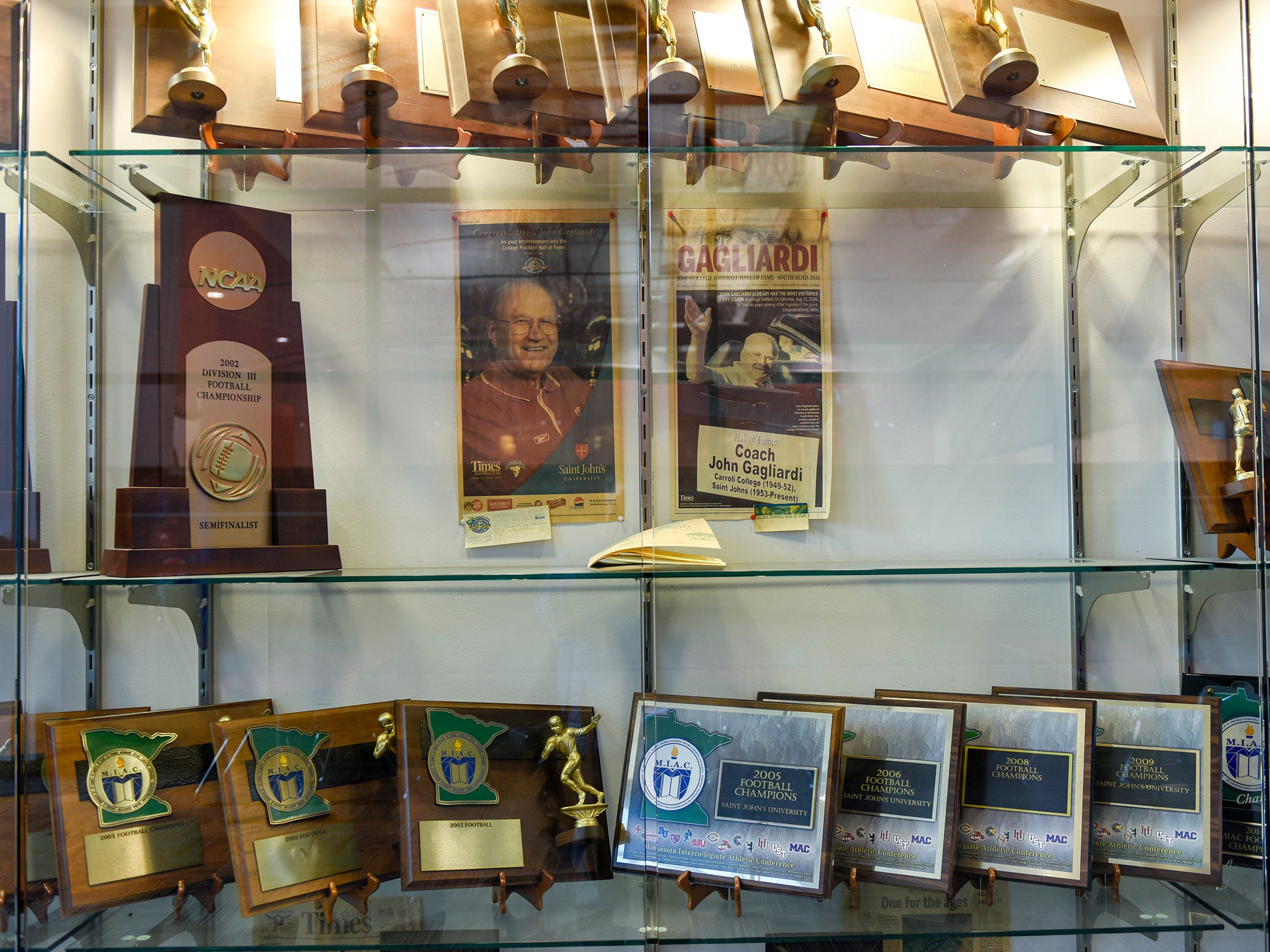 A trophy case at St. John's University shows some the the accomplishments of long time football coach John Gagliardi Monday, Oct. 15, in Warner Palaestra, Collegeville.