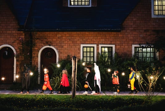 Group Of Kids With Halloween Costumes Walking To Trick Or Treating