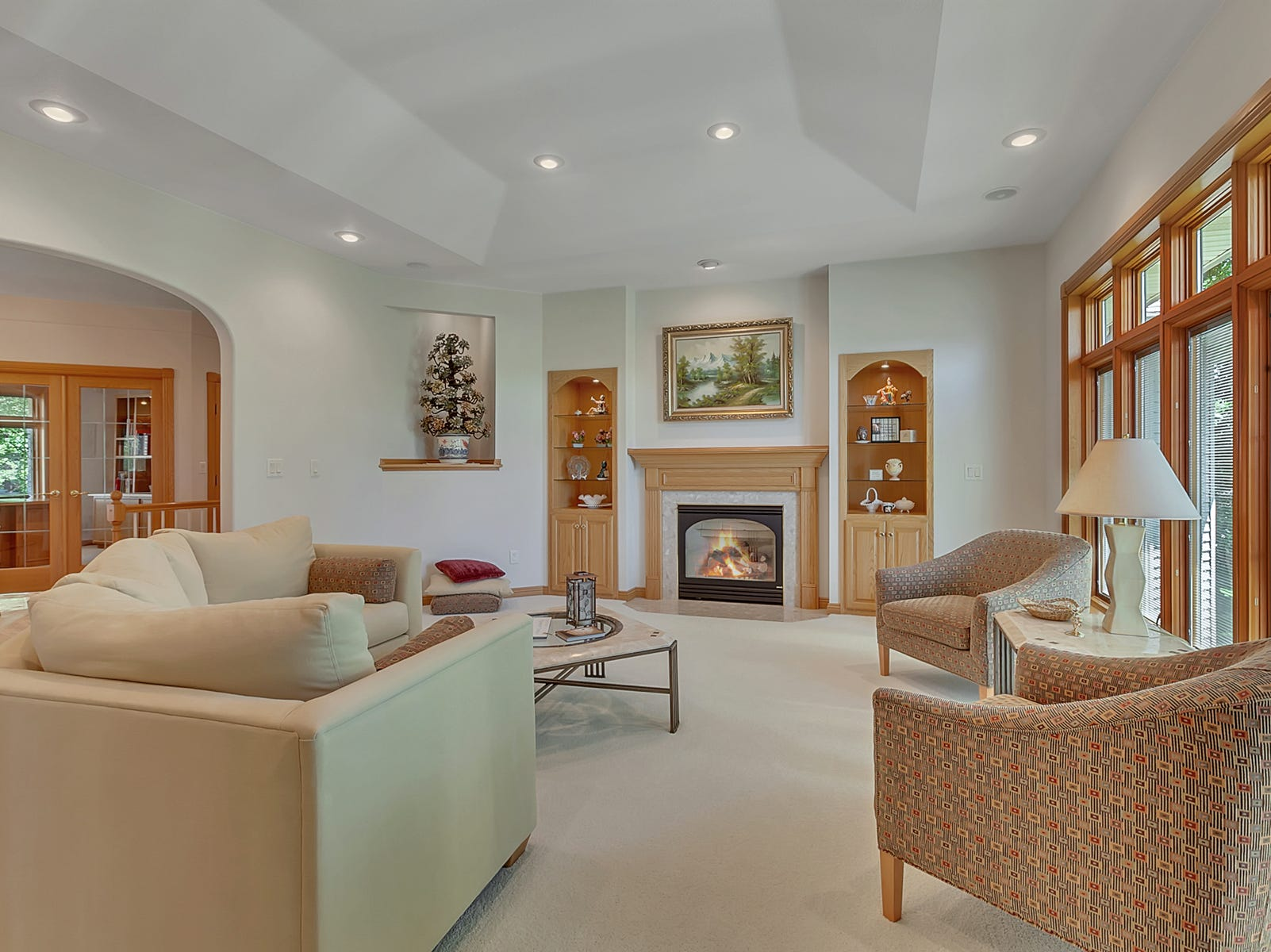 The living room, with its tray ceilings and four gorgeous archways framing its walls, is regal and inviting.