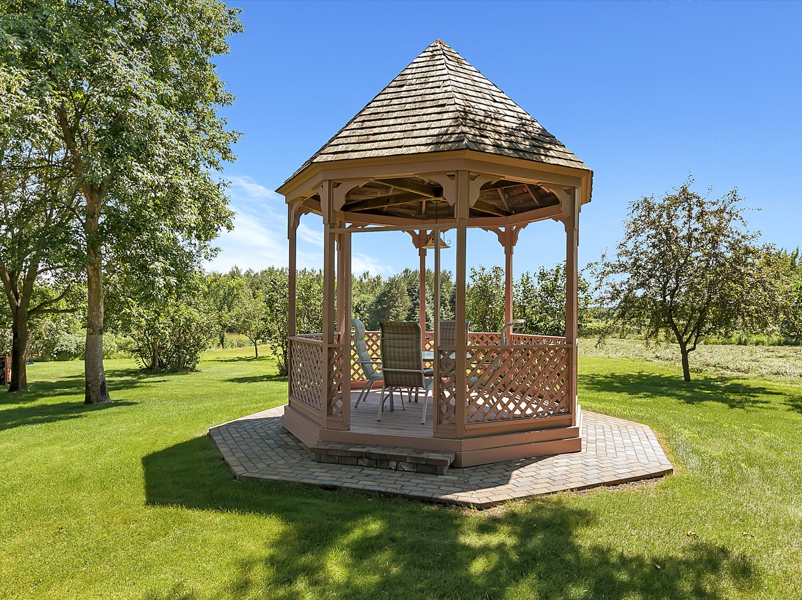 The home features a quaint gazebo to sit and relax after a hard day.