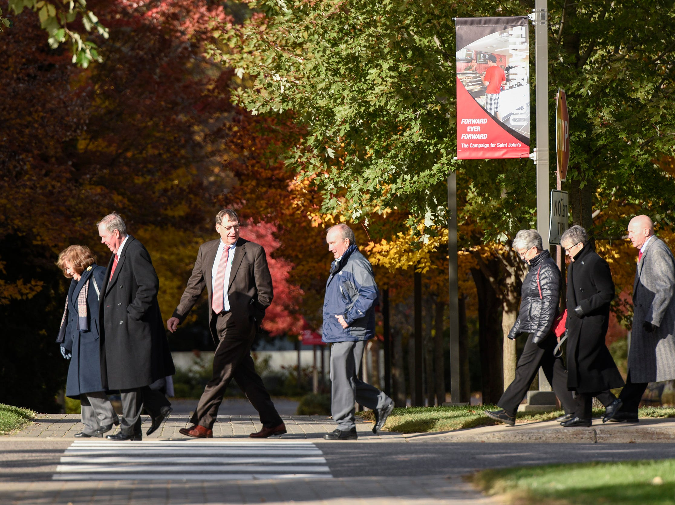 People start arriving for the funeral of long time St. John's University football coach John Gagliardi Monday, Oct. 15, at the St. John's Abbey in Collegeville.