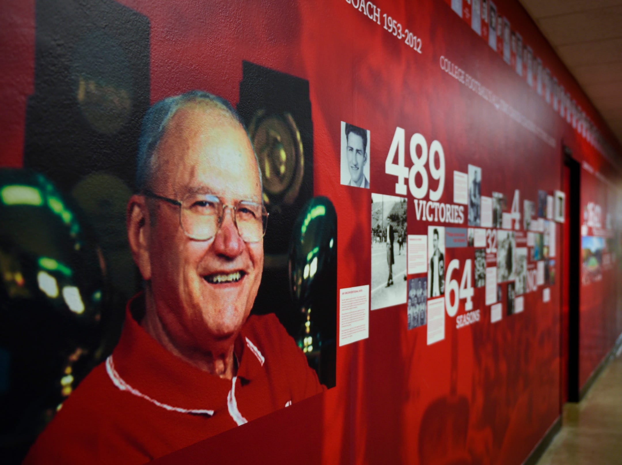 A mural depicting long time St. John's University football coach John Gagliardi's accomplishments lines the hallway of the sports department near his office Monday, Oct. 15, at the St. John's Abbey in Collegeville.