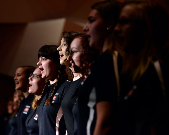 The St. Cloud State University Concert Choir performs during the inauguration  of President Robbyn Wacker at St. Cloud State University Monday.