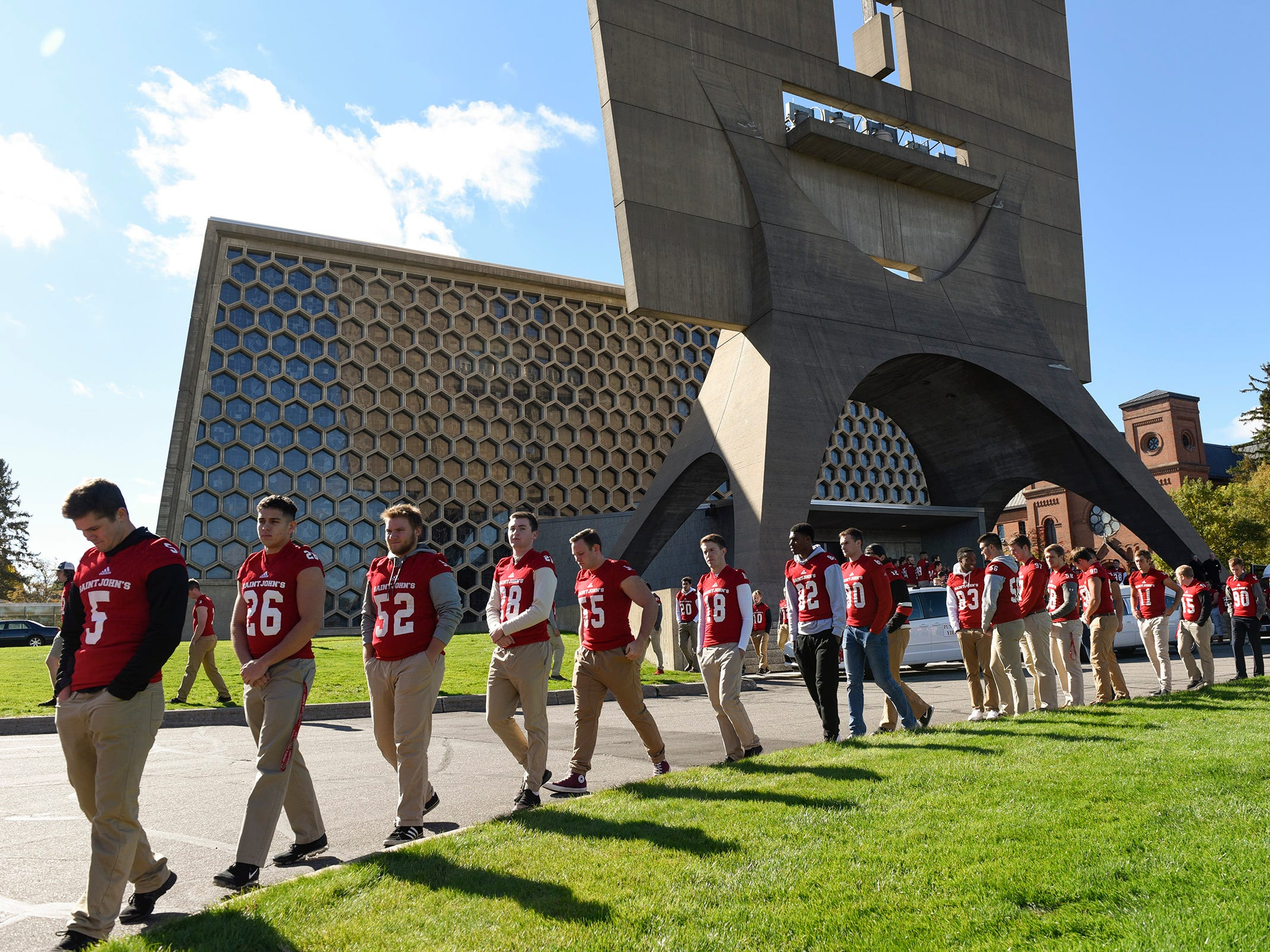 St. John's University football players line the road for long time St. John's University football coach John Gagliardi during his funeral Monday, Oct. 15, at the St. John's Abbey in Collegeville.