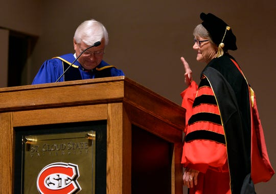 Minnesota State Board Trustee Roger Moe administers the oath of office to President Robbyn Wacker during her inauguration Monday at St. Cloud State University.