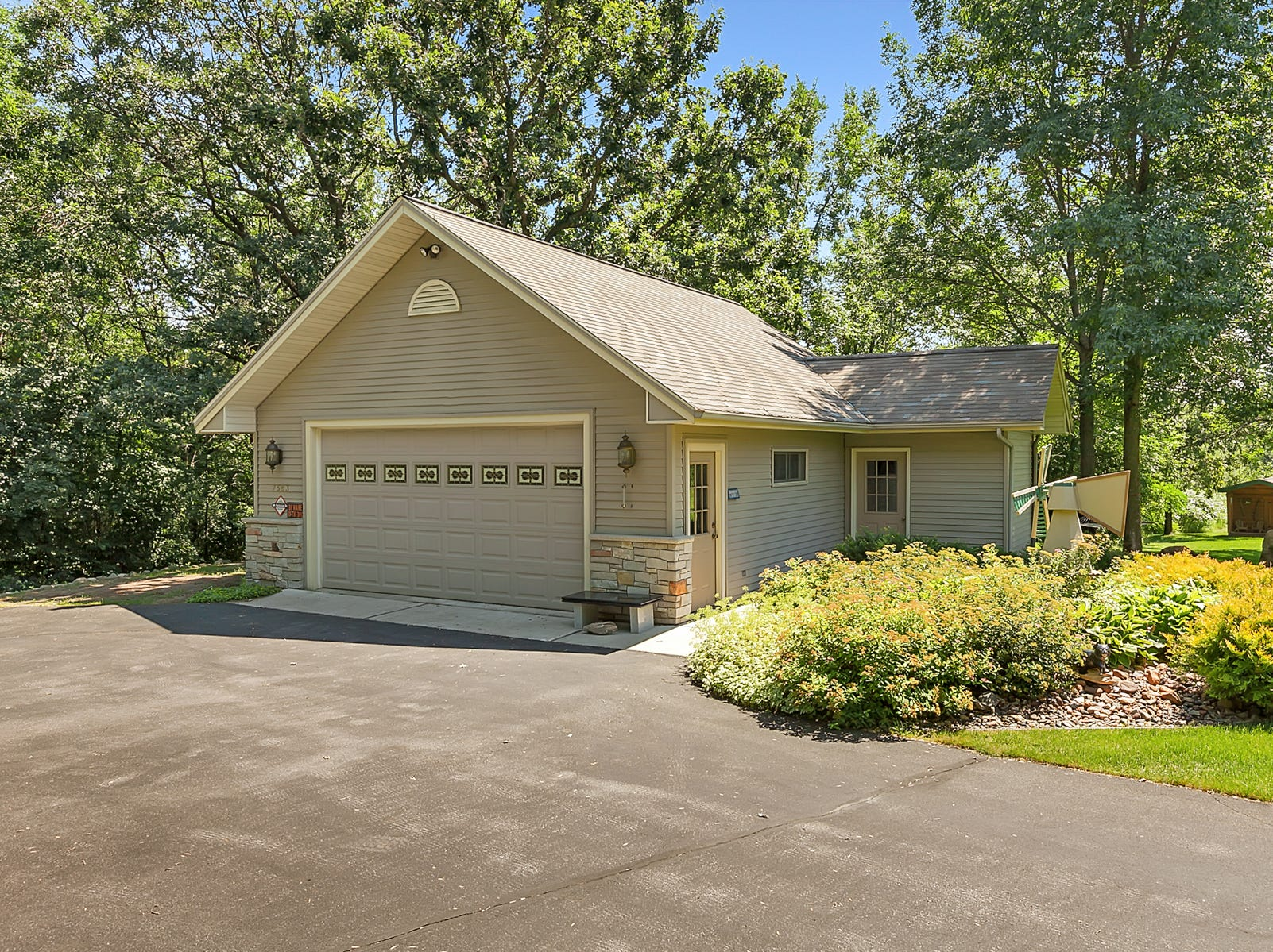 The property features a storage shed that could double as another garage.
