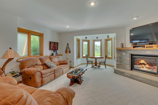 A family room can be found on the lower level of the home.
