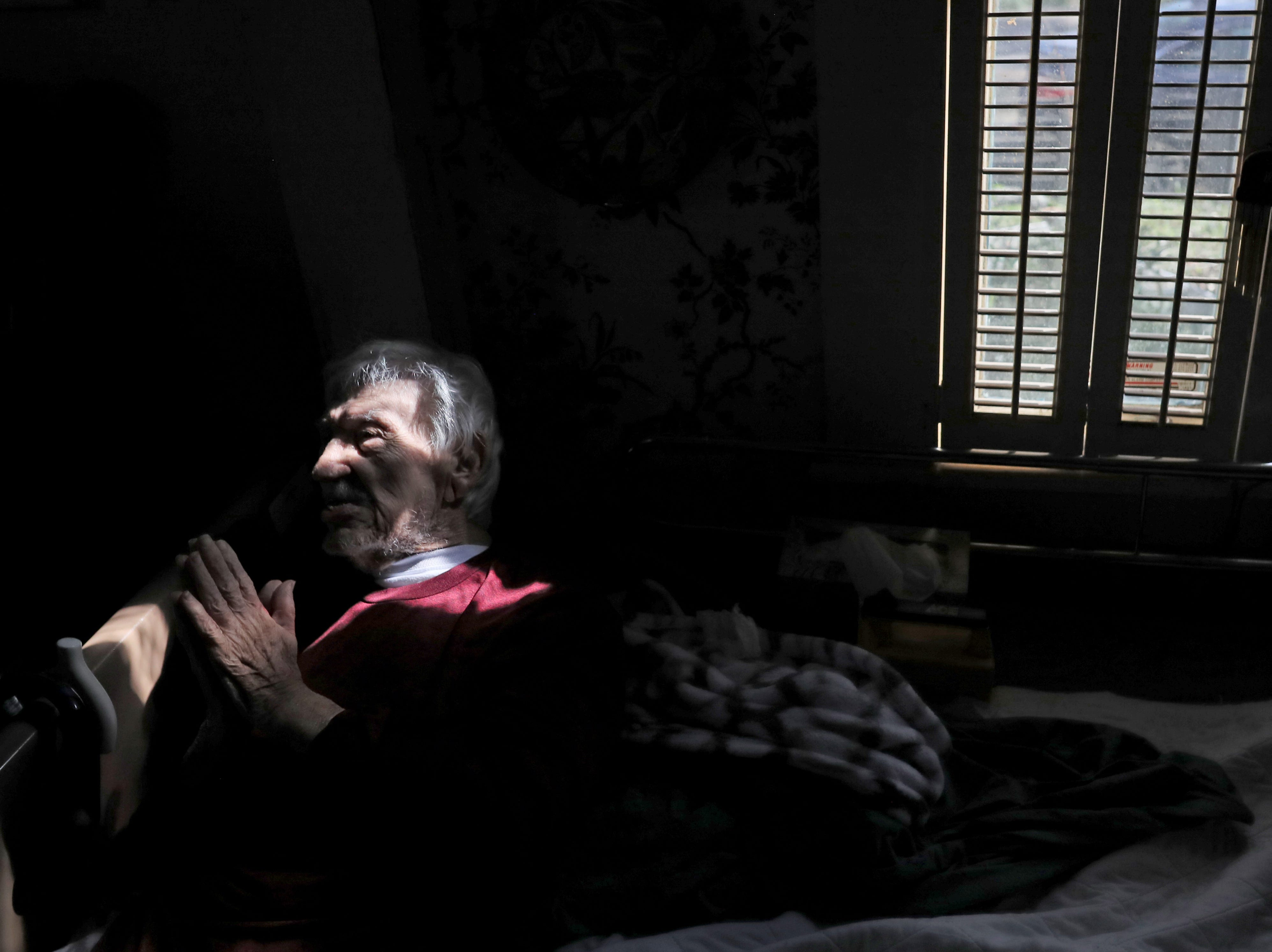 Billy Bassett King, 92, lays in the living room of his Chattahoochee home on Monday, Oct. 15, 2018. King decided to ride out Hurricane Michael inside, as trees came crashing around his house, crushing the front porch.