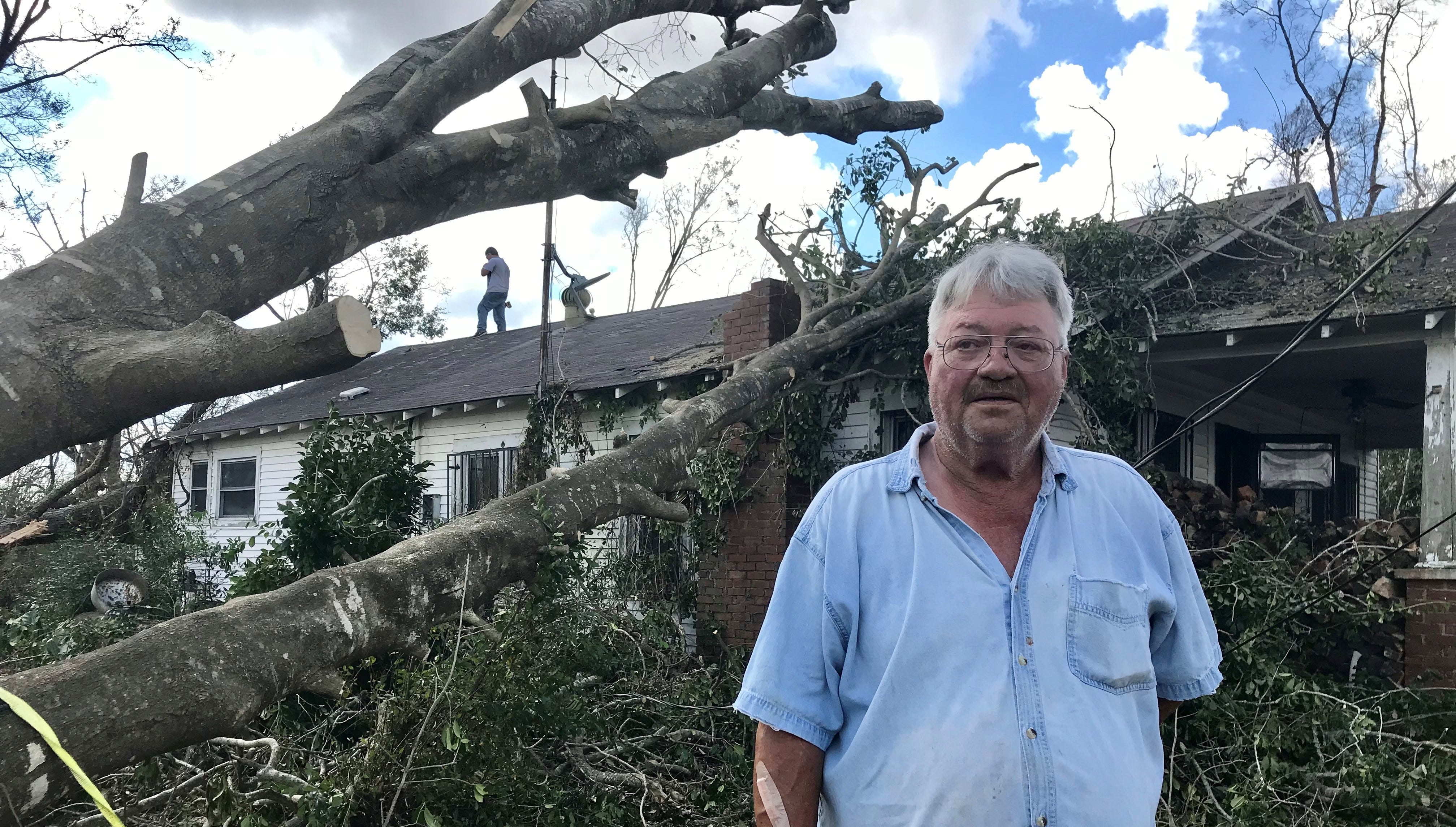 Hurricane Michael sent several trees on top of Frank and Sandy Graham's home in Altha. Family members came from Mississippi to help make repairs.