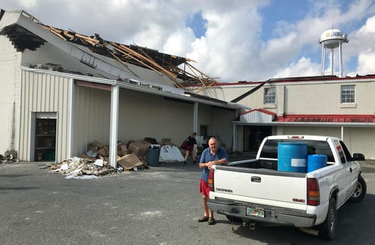Tony Hunter, whose home was badly damaged by Hurricane Michael, waits Monday for a generator at the Waldorff Ace Hardware Store in Altha. The damaged store was open and running on generator power.