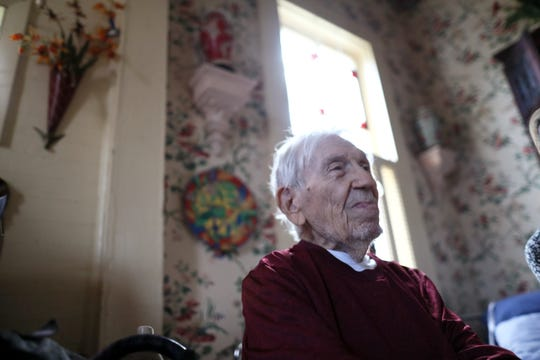 Billy Bassett King, 92, sits in the living room of his Chattahoochee home on Monday, Oct. 15, 2018. King decided to ride out Hurricane Michael inside, as trees came crashing around his house, crushing the front porch.