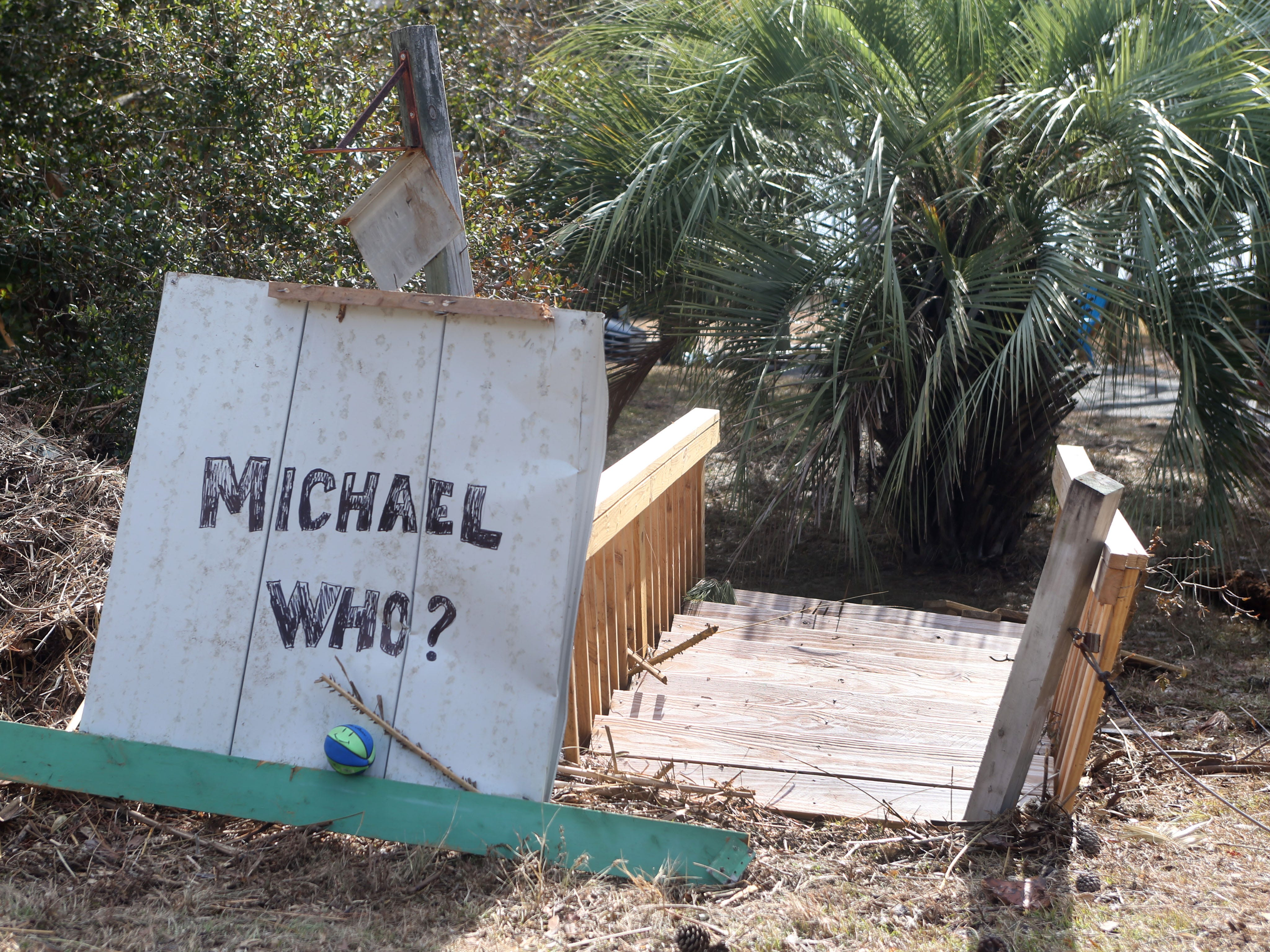 A handwritten sign displays the attitude of those affected by Hurricane Michael in Lanark Fla. on Monday, Oct. 15, 2018.