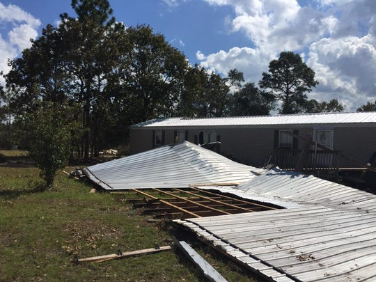 Hurricane Michael tore a three-day parking area and deck roofing from the front to the back of Ray Glisson's home on Lake Talquin.