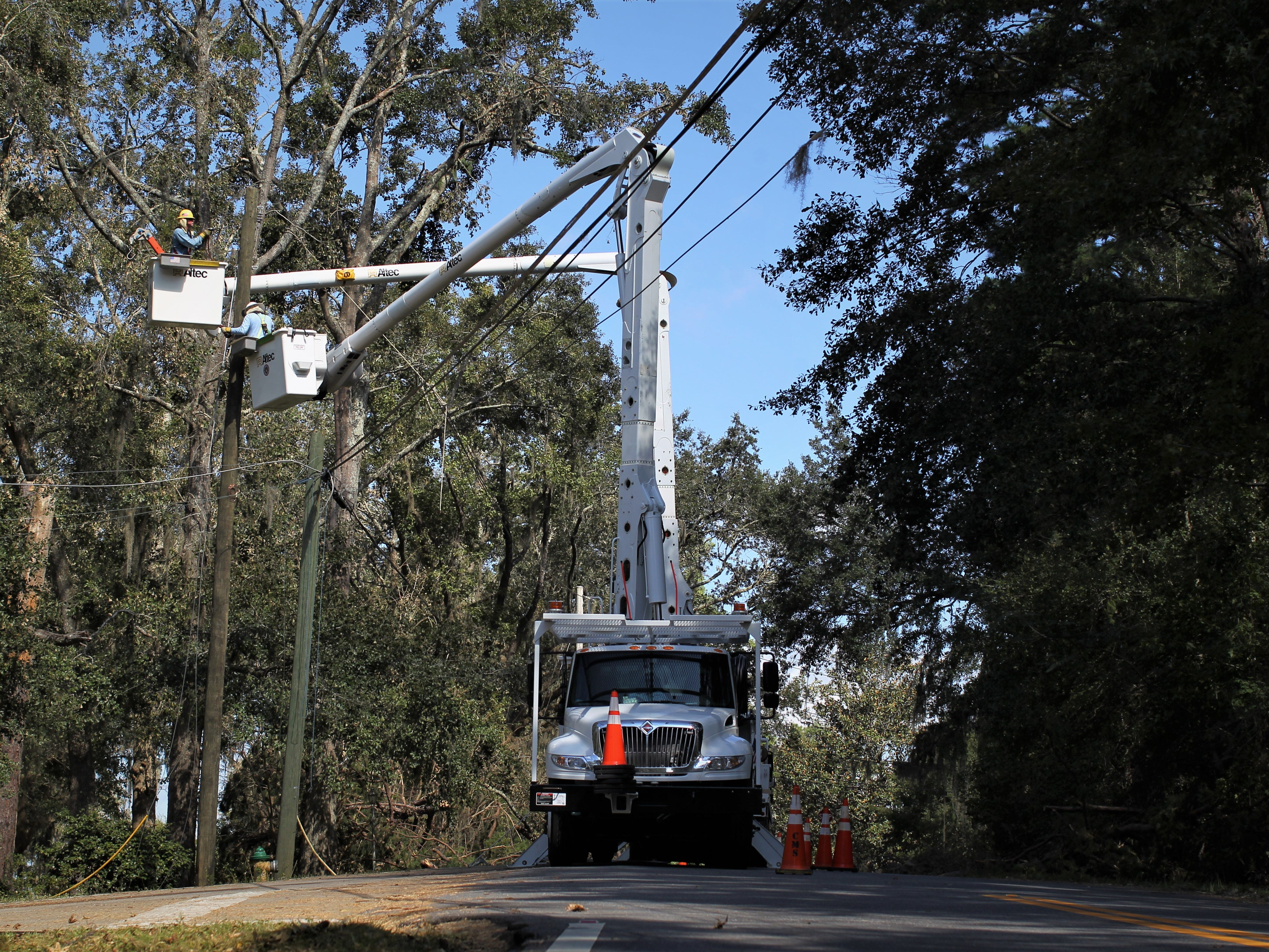 Recovery in Tallahassee along Lakeshore Drive following damage from Hurricane Michael.