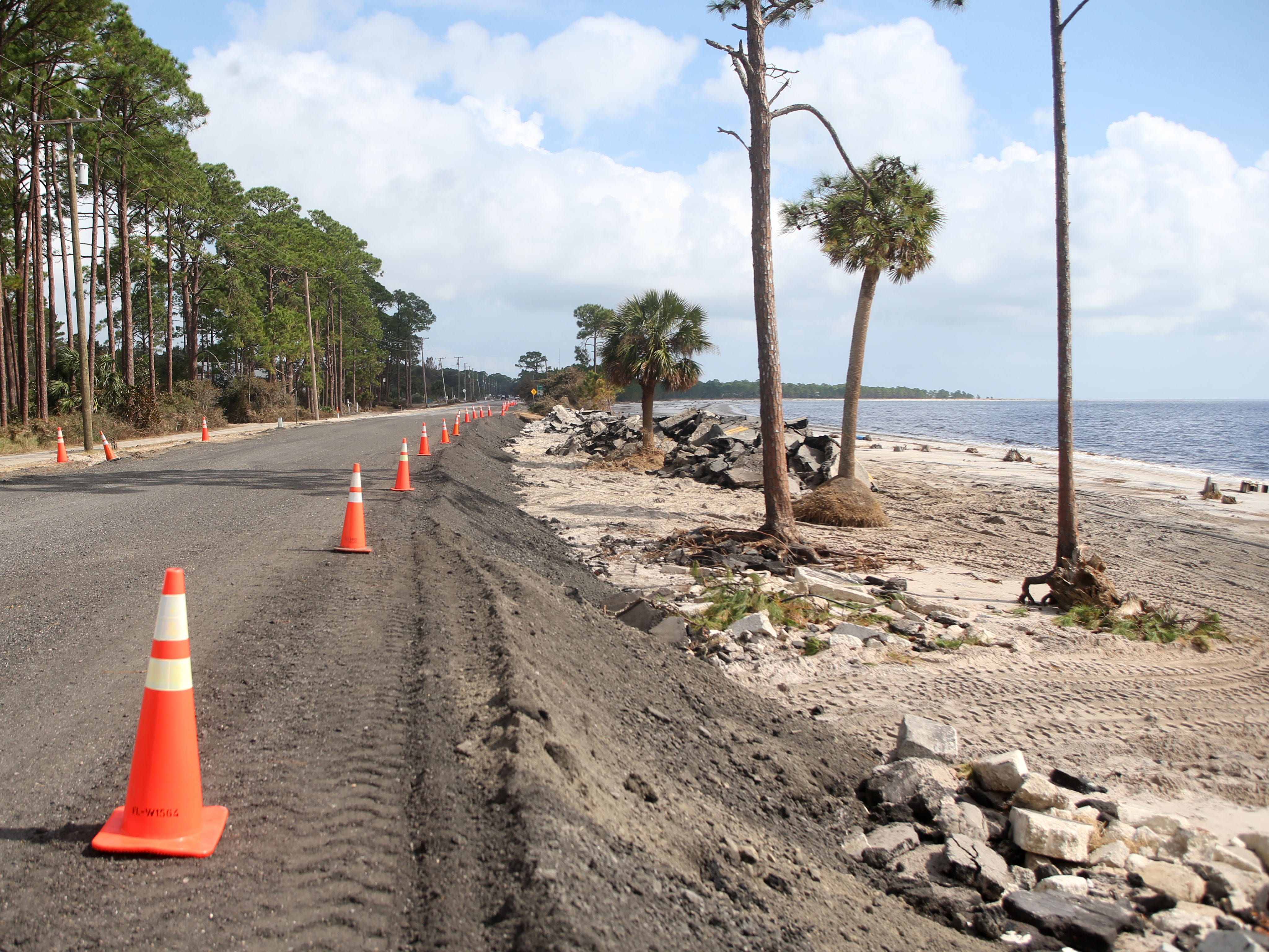 U.S. Highway 98, which was broken like puzzle pieces by Hurricane Michael, starts to see some repairs on Monday, Oct. 15, 2018.