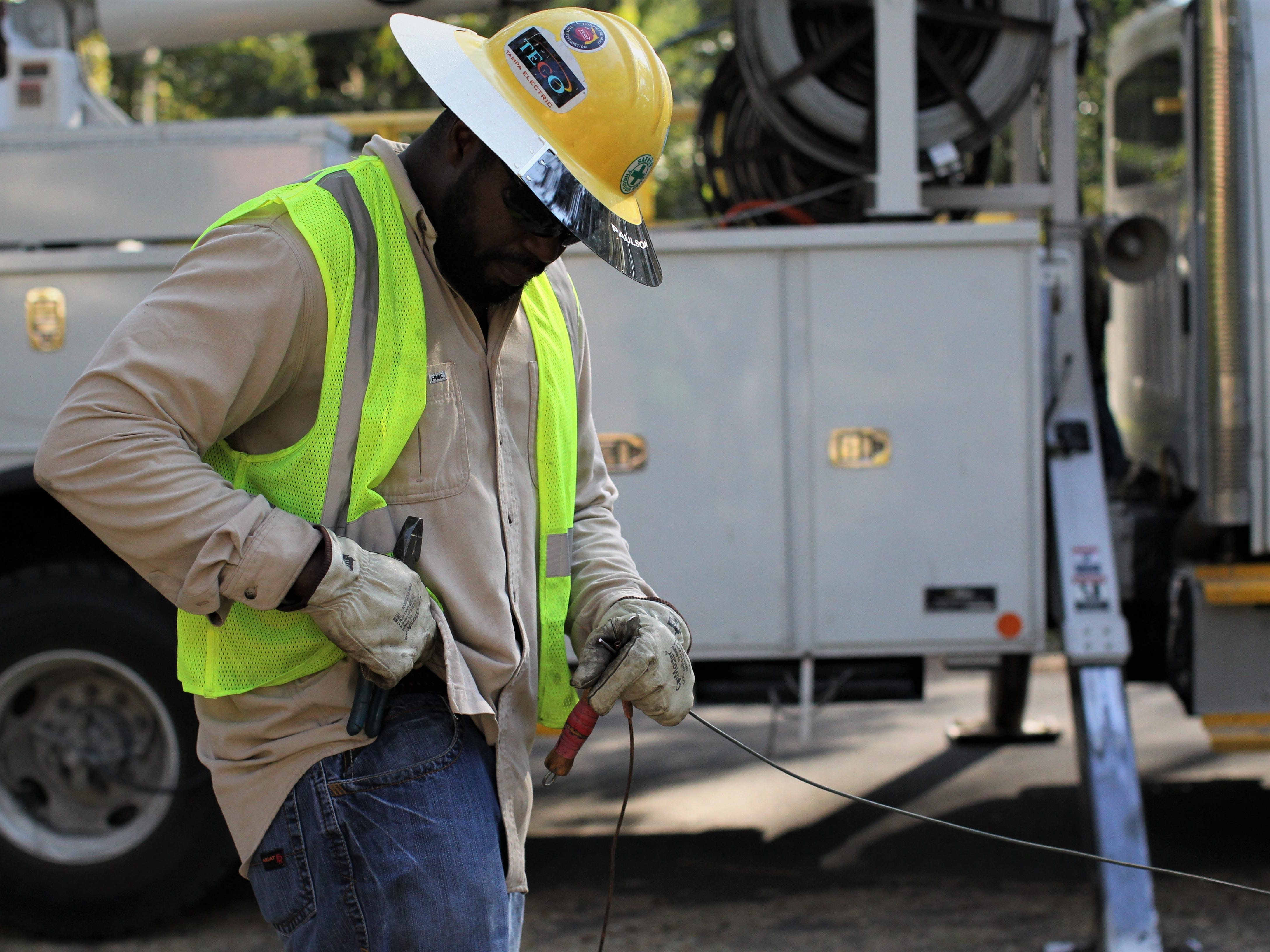 Brian Richard with Tampa Electric Company works on power line repairs in Tallahassee's Indian Head Acres following damage from Hurricane Michael.