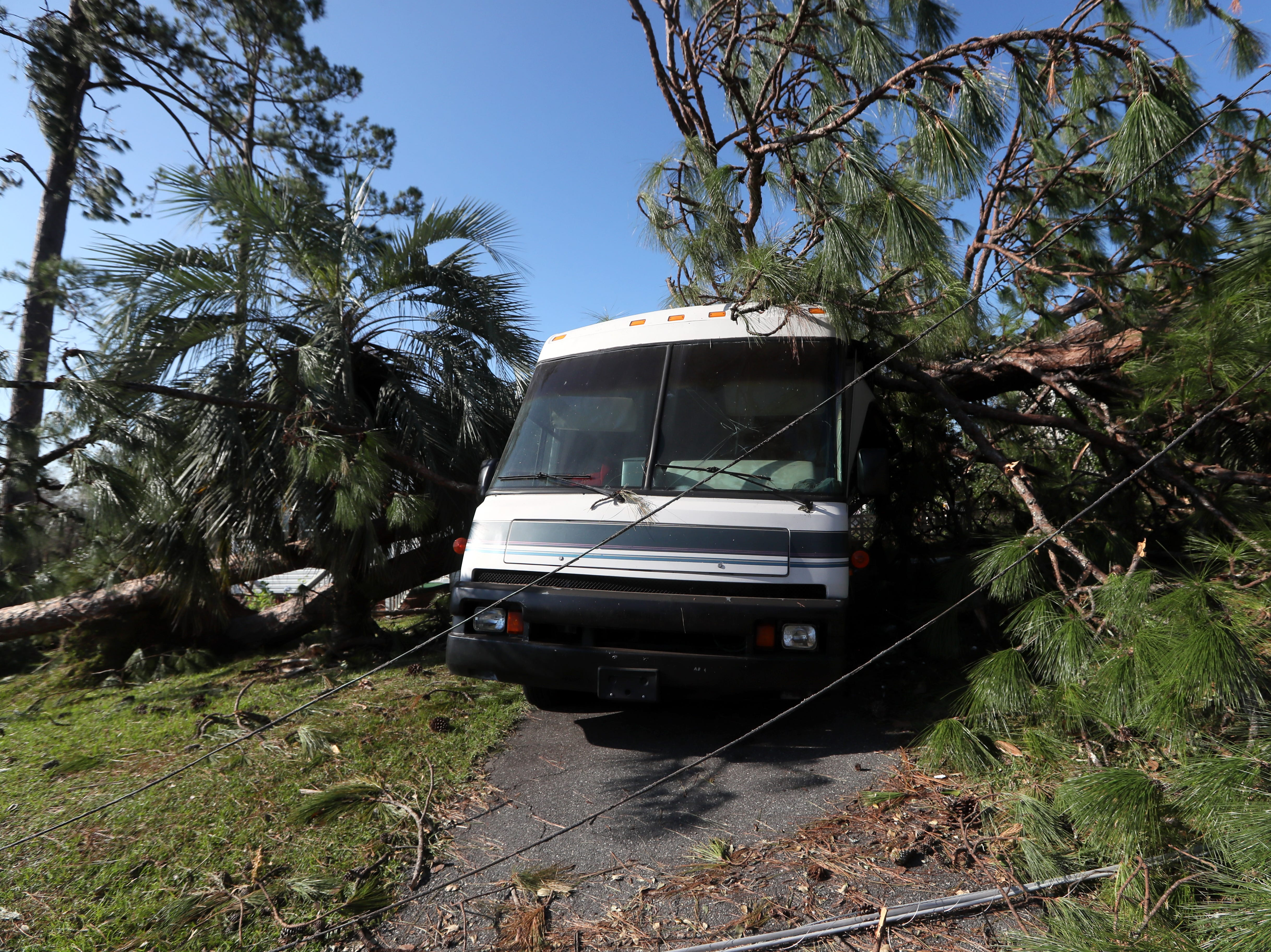An RV is left crushed by a fallen tree from Hurricane Michael at the Patrick home in Chattahoochee, Fla. Monday, Oct. 15, 2018.