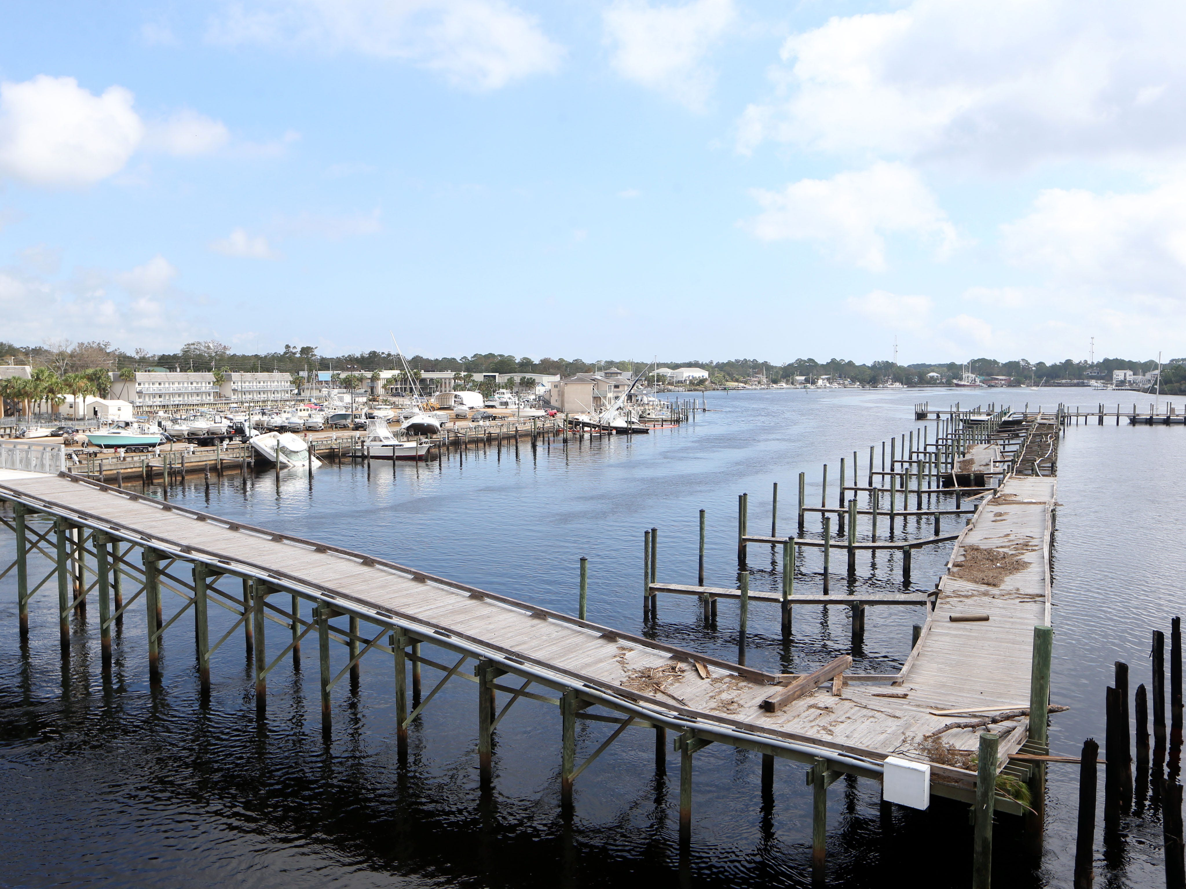 At the Carrabelle marina, boats are overturned and washed ashore on Monday, Oct. 15, 2018, after Hurricane Michael.