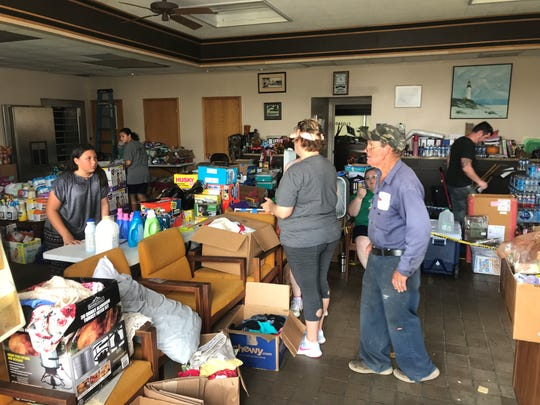 People came by Altha City Hall on Monday for food, water and supplies in the wake of Hurricane Michael.