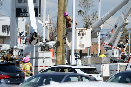 Oct. 15, 2018, Panama City, FL, USA; Linemen from all over the country work 24 hours a day to restore power to the grid in the Florida Panhandle ravaged by Hurricane Michael. Mandatory Credit: Patrick Dove/Treasure Coast News via USA TODAY NETWORK