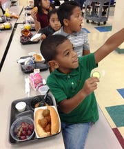 Port Salerno Elementary students enjoyed crunching on delicious cucumbers as part of the school's Farm to School month festivities