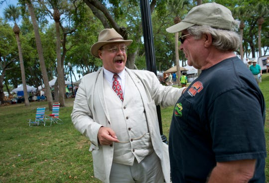 """""""It's important for me to bring the former president to life,"""" said Joe Wiegand (left), playing the part of Theodore Roosevelt, after speaking with George Spangler, of Columbus, Ohio, at the 2015 Pelican Island Wildlife Festival at Riverview Park in Sebastian."""
