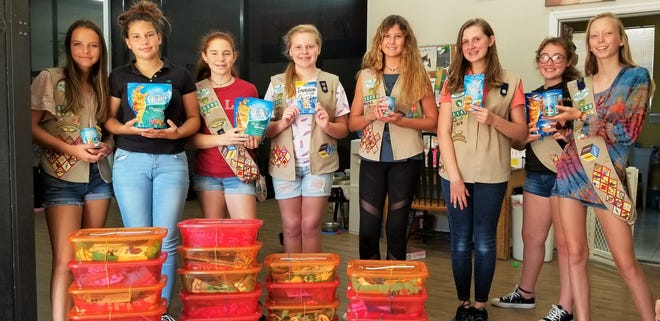 From left, Girl Scout Troop #30290 members Siena, Olivia, Katie, Abbie, Summer, Jenny, Holly and Zoe display the boxes they made for CFF's newly adopted kittens and cats.