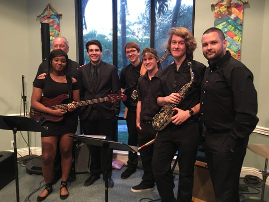 Dr. Ray Adams, back, left, founder of the Vero Beach Choral Society, and Jacob Craig, right, director of Music and Arts at First Presbyterian Church of Vero Beach, with students who participated in the June jazz workshop sponsored by Vero Vino.
