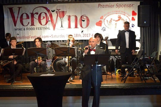 Master of Ceremonies Glenn Ferdinand introduces the Indian River Charter High School Jazz Band at the 2017 Vero Vino Wine & Food Festival.