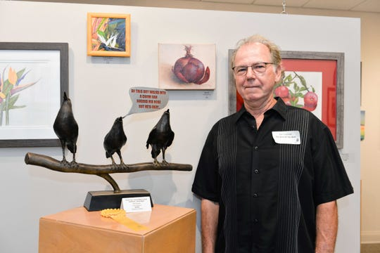 """Artist Pat Cochran with his Director's Choice award-winning sculpture """"Thank You, You've Been A Great Audience. Good Night."""""""