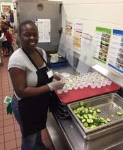 Cafeteria staff at Port Salerno Elementary School took great care to prepare students' cucumbers for sampling on Thursday, Oct. 11.