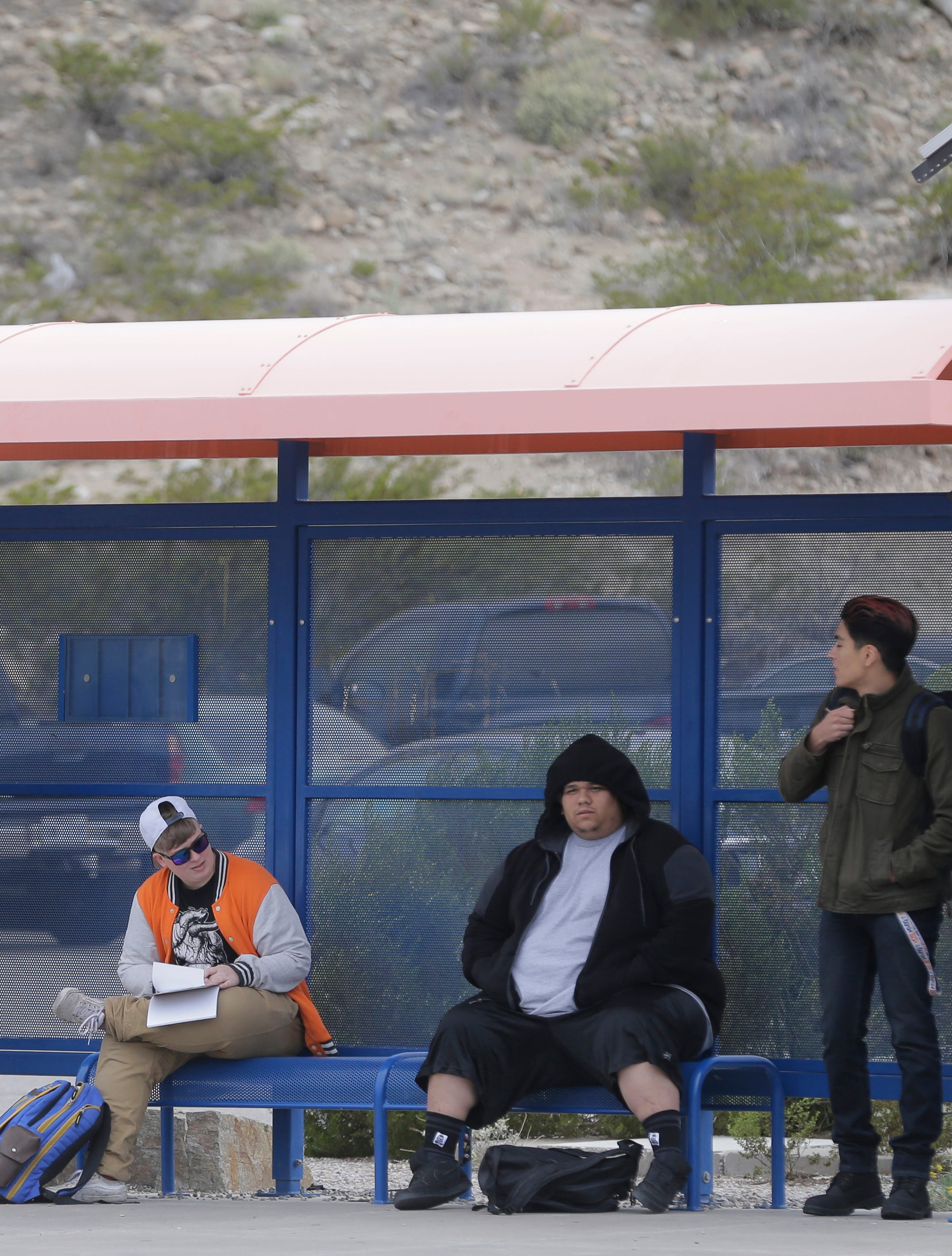 Students at UTEP wait for the shuttle to take them to campus.