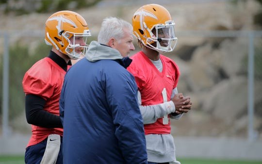 UTEP head coach Dana Dimel goes over a formation with two of his three quarterbacks, Ryan Metz and Kai Locksley, on Monday morning at practice as the team prepares for the game Saturday against Louisiana Tech in Ruston, La., which has a 1:30 p.m. MT kickoff.